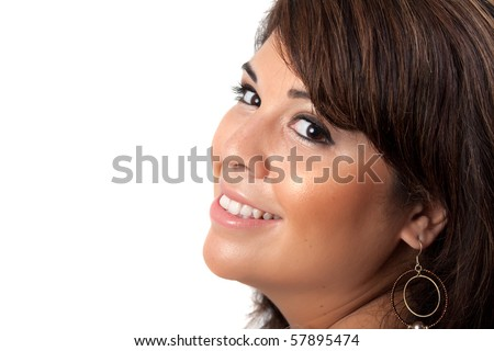 A smiling Spanish model with a very clear complexion isolated over a white background.  She has black hair with brown highlights.