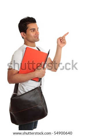 A smiling student with satchel and notebook, looking and pointing to your message.  White background. - stock photo
