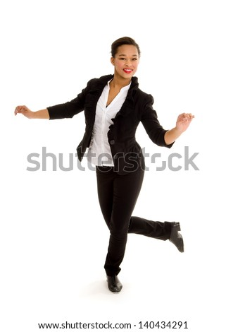 A Smiling Tap Dancing Girl in Black Costume Performs a Dance Routine - stock photo
