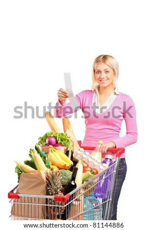 A smiling woman checking her shopping receipt isolated on white background - stock photo