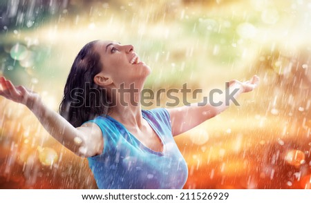 a smiling woman happy rain - stock photo