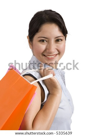 A smiling woman holding some shopping bags over a  white background