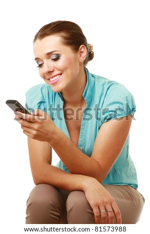 A smiling woman is sitting with mobile phone isolated on white - stock photo