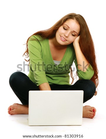 A smiling woman is working with a laptop on white background