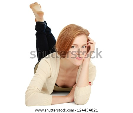 A smiling woman lying on the floor, isolated on white background