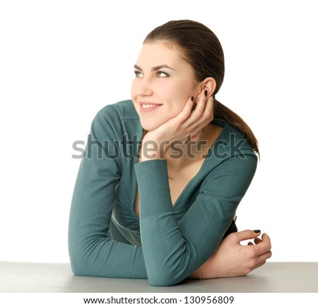 A smiling woman sitting at the desk, isolated on white background - stock photo