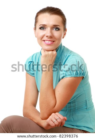 A smiling woman sitting isolated on white background - stock photo