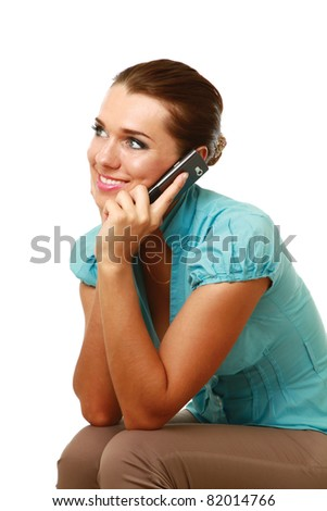 A smiling woman using a mobile phone, isolated on white - stock photo