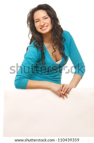 A smiling woman with a blank - stock photo