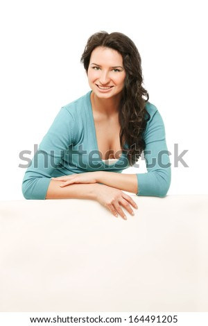 A smiling woman with a blank, isolated on white background - stock photo