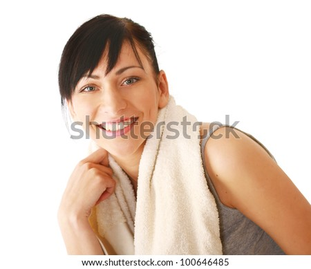 A smiling woman with a towel, isolated on white - stock photo