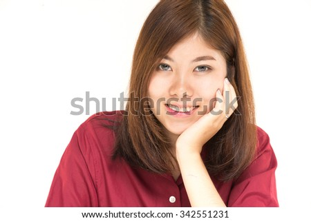 a smiling young asian female in her 20s smiling on white background in studio shot (with selective focus) - stock photo