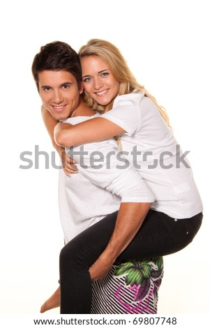 A smiling young couple having fun and joy. - stock photo