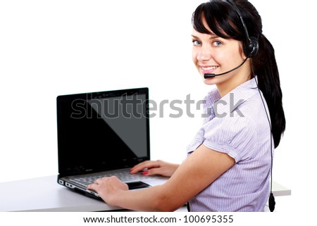 A smiling young customer service girl with a headset at her workplace, closeup, isolated on white background - stock photo