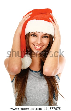 A smiling young woman in a Christmas hat, isolated on white background - stock photo