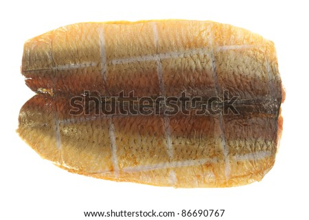 A smoked herring, or kipper, isolated over a white background.