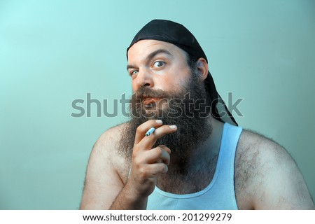 A smoking redneck questions his beliefs - stock photo
