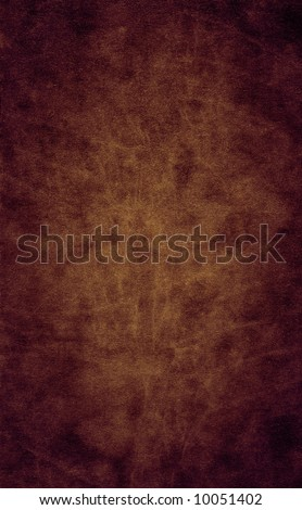 A smooth brown leather close-up, suitable as a background texture. - stock photo