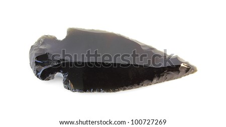 A smooth, chiseled, Native American Indian arrowhead isolated on white. - stock photo