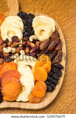 A snack platter of dried fruit and nuts for the holidays or party.