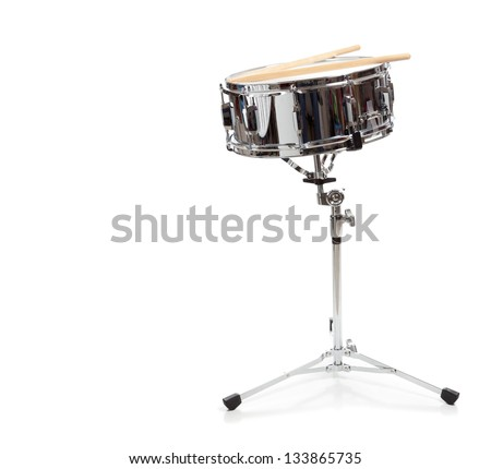 A snare drum with drumsticks on a white background - stock photo