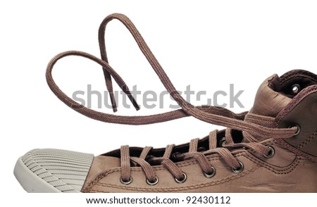 a sneaker boot with its shoelaces tied as a heart - stock photo