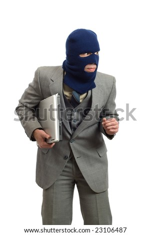 A sneaky thief is stealing a new computer, isolated against a white background - stock photo