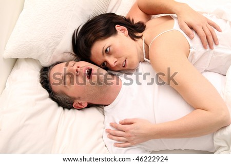 a snoring man with his wife