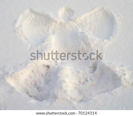 A snow angel made in the white snow. - stock photo