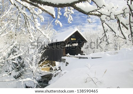 A snow blanketed Emily's covered bridge in Stowe Vermont, USA - stock photo
