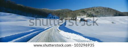 A snow covered farm in Vermont - stock photo
