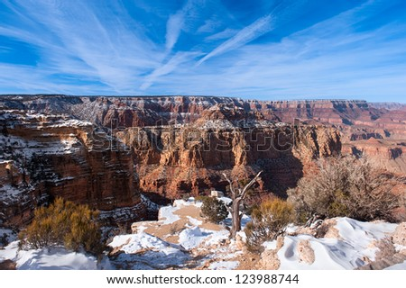 A snow covered ledge overlooking the grand Canyon at Lipon Point.