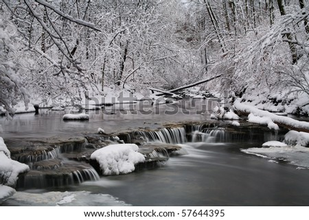 A Snow Covered Little Creek And Waterfall In Winter, Keehner Park, Southwestern Ohio - stock photo