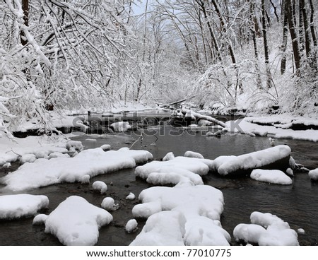 A Snow Covered Little Creek In Winter, Keehner Park, Southwestern Ohio - stock photo