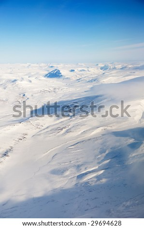 A snow covered mountain landscape - Spitsbergen, Svalbard Norway