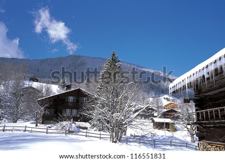A snow covered village on a hillside - stock photo