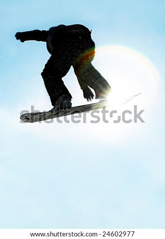 A snowboarder going big high above the half pipe - stock photo
