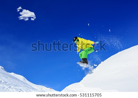 A snowboarder on the piste in Alps in Austria