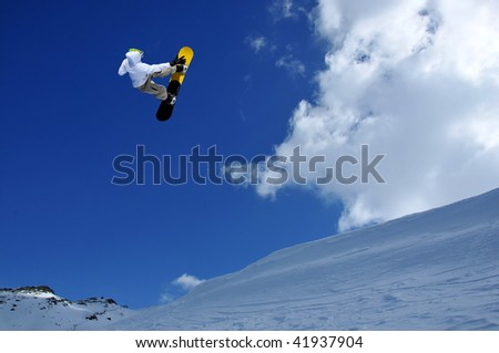 a snowboarder performing a high jump