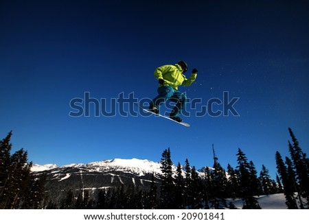 A snowboarder takes flight on Whistler Mountain.