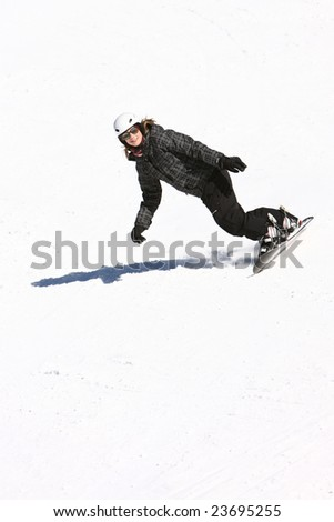 A snowboarding girl in black - stock photo