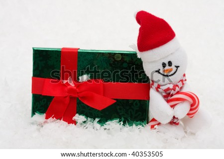 A Snowman with a present on a  snowflake background, snowman