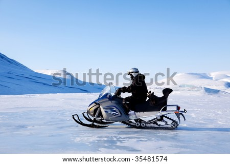 A snowmobile on a beautiful winter mountain landscape