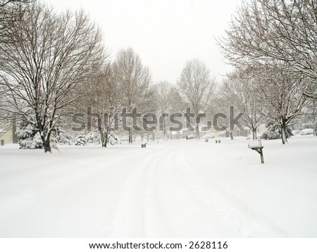 A snowy neighborhood scene in New Jersey during a blizzard. - stock photo