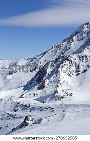 A snowy winter landscape of a ski resort in the Alps. - stock photo