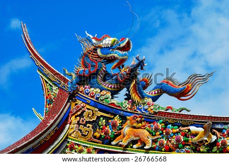 A soaring dragon on the roof top of a temple. - stock photo