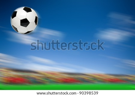 a soccer ball flying against the backdrop of the stadium in action - stock photo