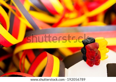 a soccer ball, streamers and gummy bears - stock photo