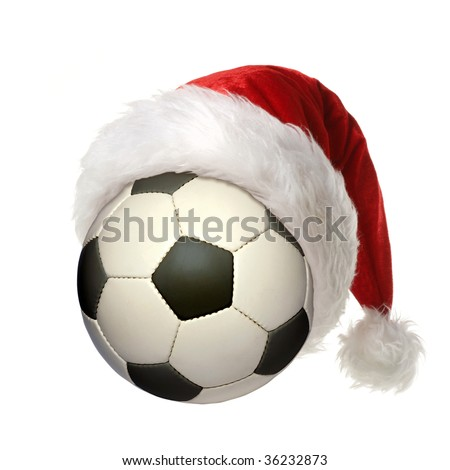 a soccer ball with a Christmas hat - stock photo