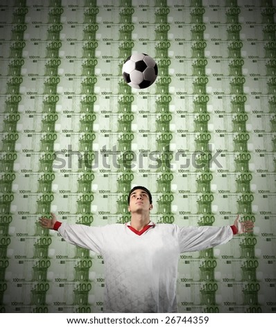 a soccer champion on a money background - stock photo